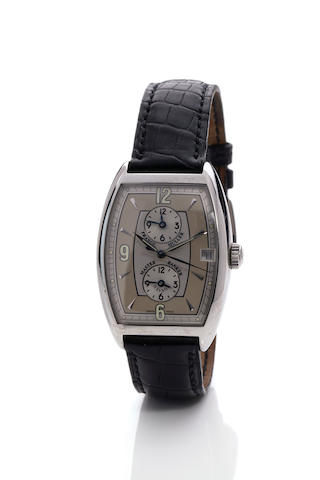 Franck Muller. A stainless steel triple time zone automatic curved tonneau calendar wristwatch with center secondsMaster Banker Havana, Ref. 2852, No. 11, 1990's