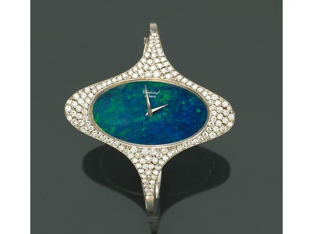 An opal, diamond and eighteen karat white gold wristwatch bangle, Chopard