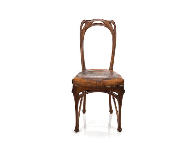 A fine and rare Hector Guimard carved walnut sidechair designed for the Maison Coillot, circa 1900