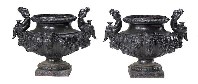 A pair of French black painted cast iron garden urns <br>J.J. Ducel et Fils foundry