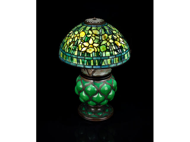 A Tiffany Studios Favrile glass and bronze Daffodil lamp on reticulated bronze base 1899-1918