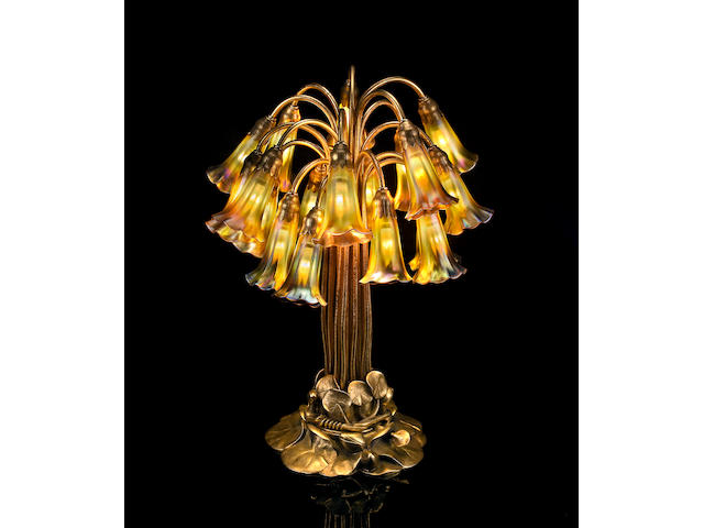 A Tiffany Studios Favrile glass and gilt bronze eighteen light Lily lamp 1899-1918