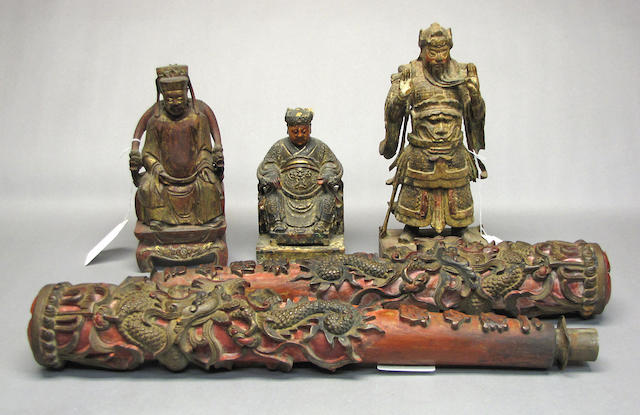 A group of three Carved wood Daoist Divinities, together with a pair of carved wood temple candles