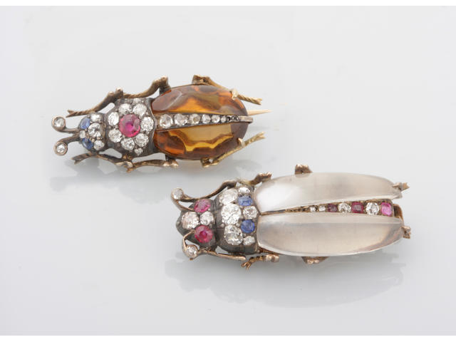 A pair of diamond, gem-set and gold insect brooches
