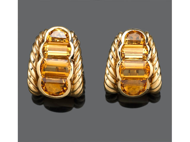 A pair of citrine and fourteen karat gold earclips