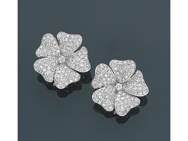 A pair of diamond floral earrings