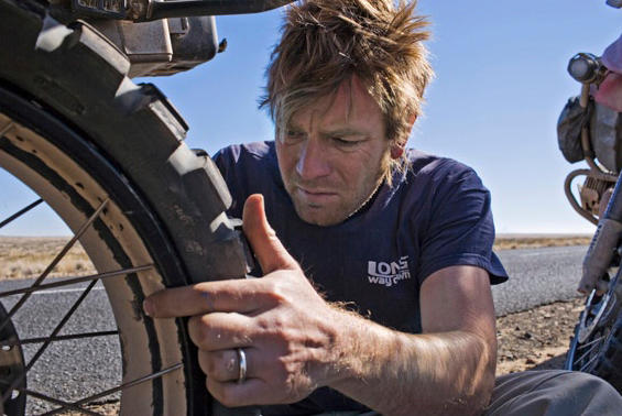 A collection of 32 pictures of Scotsman Ewan McGregor and Englishman Charley Boorman from their Long Way Down motorcycle odyssey, 27 photographs are 22 x 26in, five are 26 x 30in