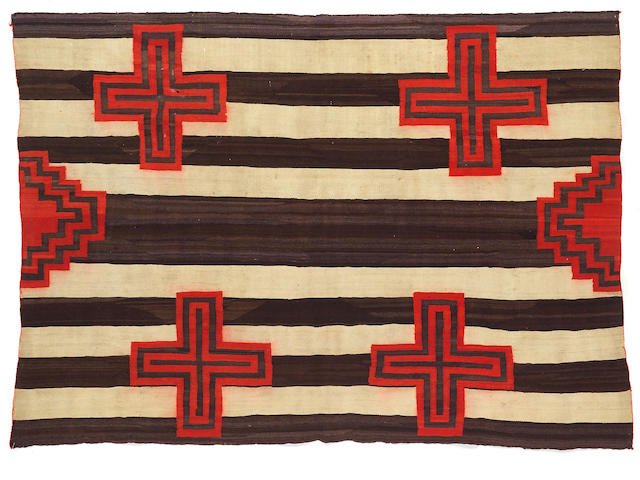 A Navajo transitional chief's design weaving, 4ft 10in x 6ft 8in