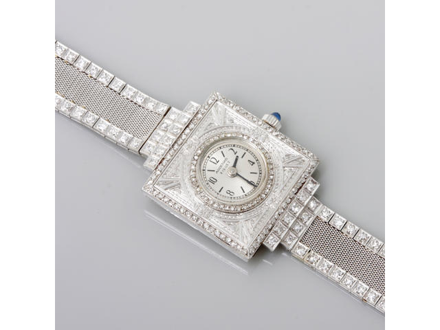 A diamond and platinum bracelet wristwatch,