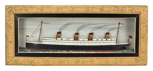 "A waterline shadow-box of the R.M.S. ""TITANIC"" 17 x 40 x 4 in. (43.1 x 101.6 x 10.2 cm.)"