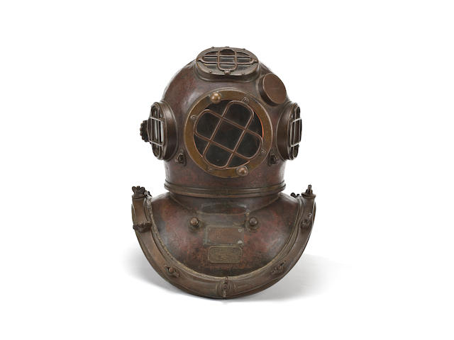 "An important diver's helmet used during the salvage of the S.S. ""Normandie""  circa 1938 19 x 15 in. (48.3 x 38.1 cm.)"