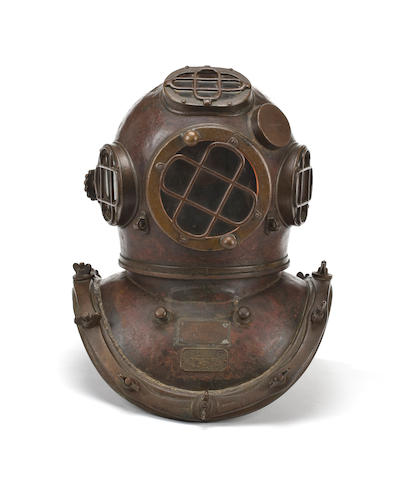 """An important diver's helmet used during the salvage of the S.S. """"Normandie""""  circa 1938 19 x 15 in. (48.3 x 38.1 cm.)"""