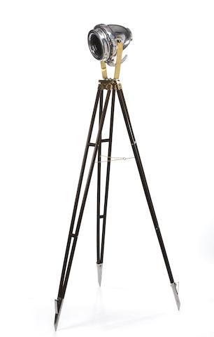 A chrome searchlight on tripod stand  74 x 12 in. (188 x 30.5 cm.) height on tripod x head width 2