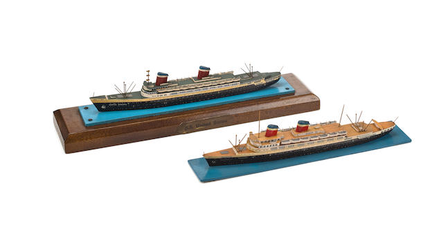 A pair of miniature waterline models of United States Lines ships  circa 1965 12 x 3 x 3 in. (30.5 x 7.6 x 7.6 cm.) and smaller 2