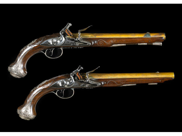 A pair of silver-mounted English flintlock pistols by John Bumford