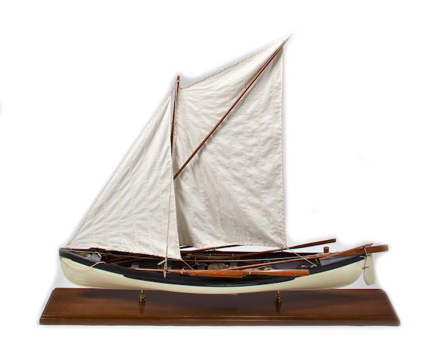 A model of a whaleboat  48 x 9.1/2 x 40 in. (121.9 x 24.1 x 101.6 cm.) model on board.
