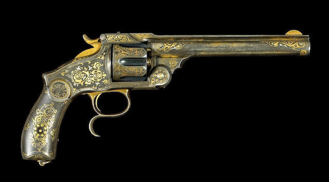 A gold and silver damascened Spanish copy of a large frame Smith & Wesson revolver