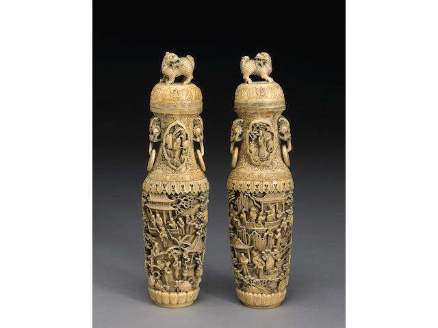 A pair of pieced and tinted ivory vases and covers