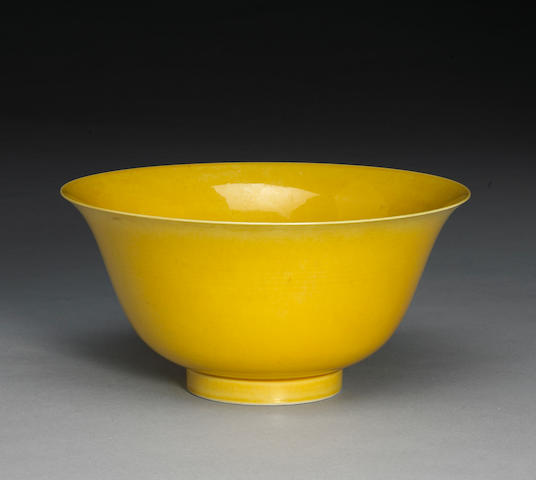 A yellow glazed porcelain bowl (hairline crack)