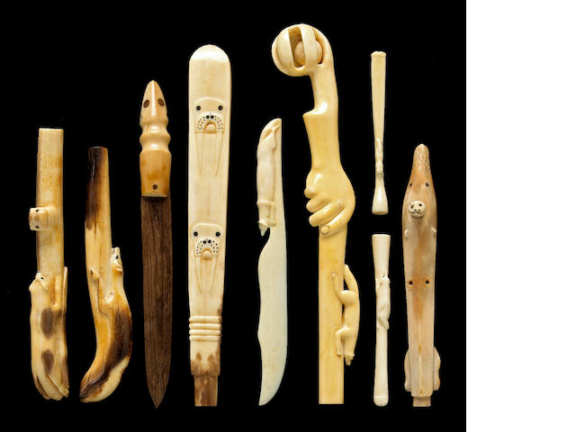 A group of Eskimo ivory handles and other curios