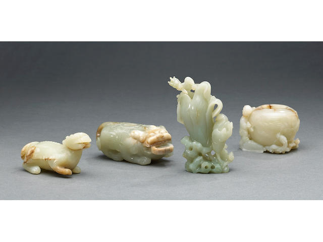 A group of four nephrite carvings, a bixi with figural decoration (restored), a lion form bixi, a qi