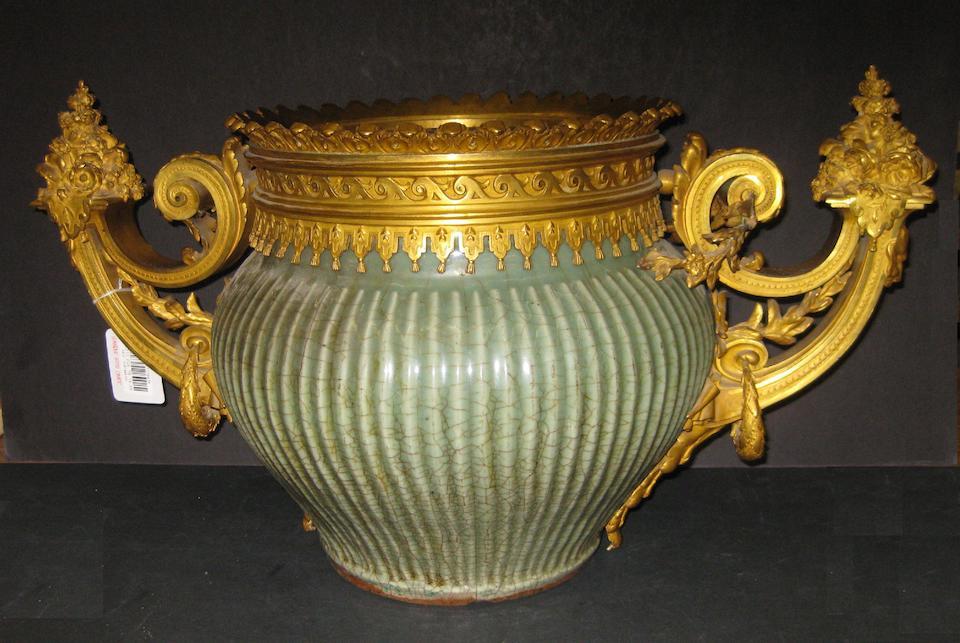 A fine Régence style gilt bronze mounted Chinese celadon glazed stoneware jar  the bronze first half 19th century, the jar Ming Dynasty