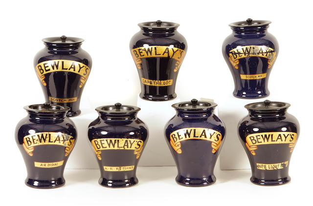 A group of seven Doulton glazed earthenware covered jars