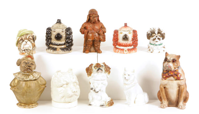A group of ten Continental glazed earthenware and porcelain tobacco jars of canine interest