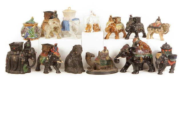 A group of thirteen Continental earthenware and porcelain tobacco jars modeled mostly as elephants