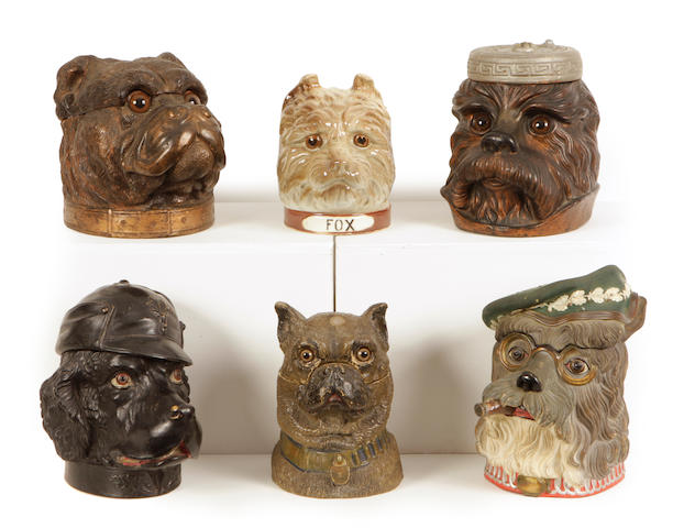 A group of six Continental earthenware tobacco jars of canine interest