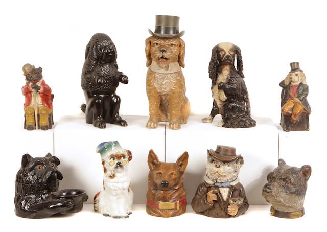 A group of ten Continental earthenware and carved hardwood tobacco jars of canine interest