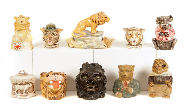 A group of ten Continental earthenware tobacco jars modeled mostly as lions and big cats