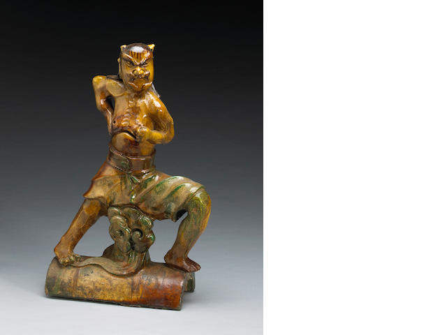 A Chinese chestnut glazed guardian figure from a roof tile 19th century