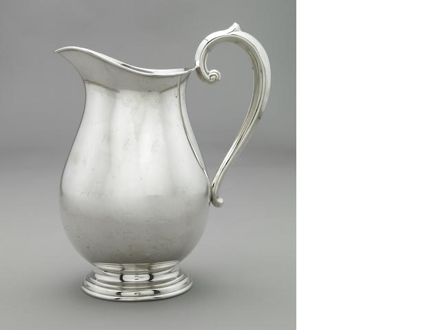 An American sterling water pitcher by FB Rogers Silver Company