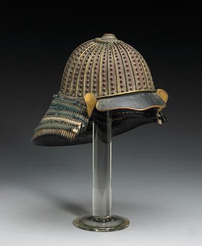 A Japanese Samurai helmet 1700-1750<Br>Caga School<Br>Signed Yoshimchi Saku