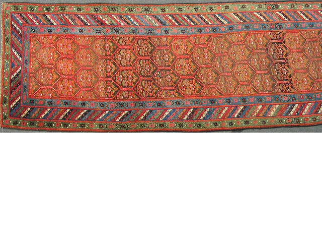 A Kurdish runner Northwest Persia, size approximately 3ft. 5in. x 15ft. 9in.