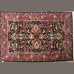 An Indian carpet size approximately 2ft. 7in. x 9ft. 11in.