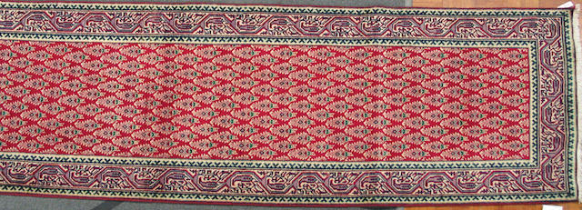 A Tabriz design runner size approximately 2ft. 11in. x 12ft. 8in.