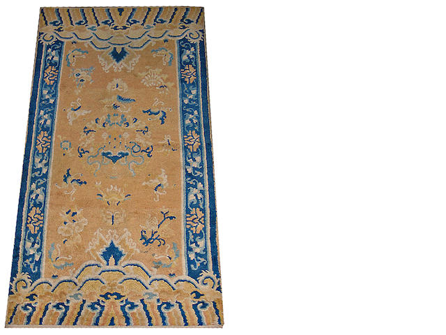 A Ningxia golden yellow ground carpet Late 19th/Early 20th Century
