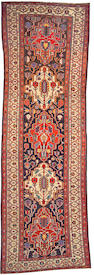 A Bakhtiari long carpet Southwest Persia, size approximately 4ft. 11in. x 15ft. 3in.