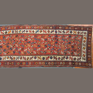 A Kurdish runner size approximately 3ft. x 10ft. 4in.