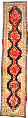 A Malayer runner Central Persia, size approximately 2ft. 11in. x 13ft. 10in.