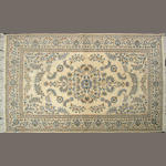 A Kashan carpet size approximately 4ft. 6in. x 7ft.