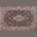 An Indian carpet size approximately 2ft. 8in. x 9ft. 11in.