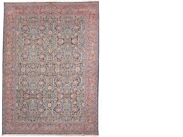 A Kerman carpet size approximately 11ft. 10in. x 16ft. 5in.