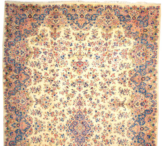 A Kerman carpet size approximately 14ft. 8in. x 25ft.