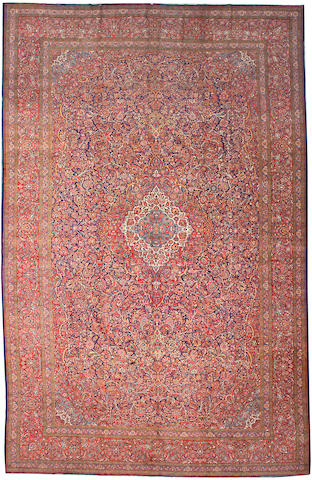 A  Kashan carpet size approximately 11ft. 10in. x 18ft. 6in.