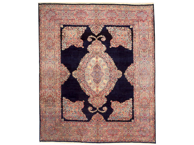 A Kerman carpet size approximately 9ft. 7in. x 11ft. 6in.