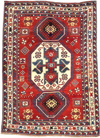 A Kazak carpet size approximately 5ft. 4in. x 8ft. 2in.