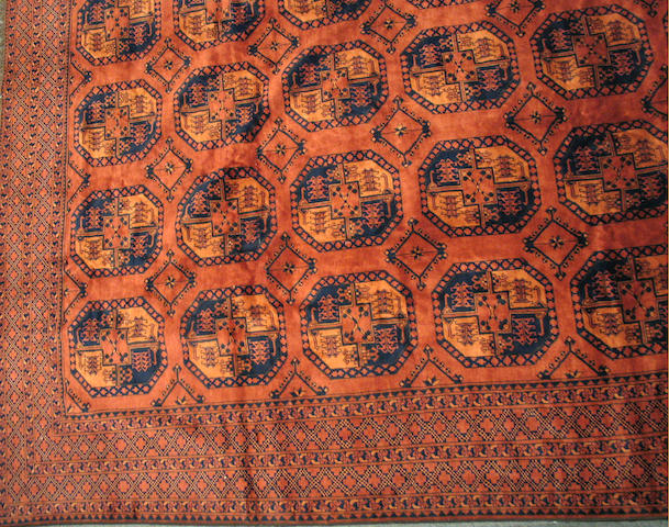 An Afghan carpet size approximately 10ft. x 13ft.